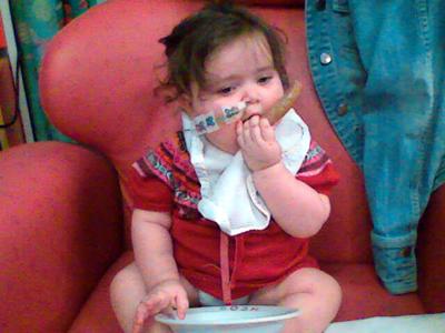 Jasmine eating a sausage