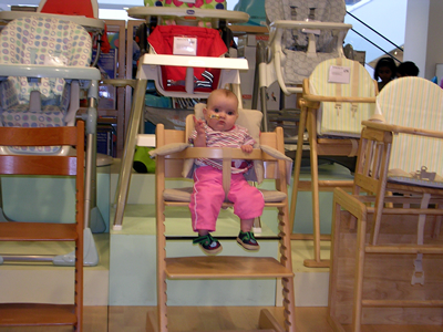 Jasmine trying out the baby chairs
